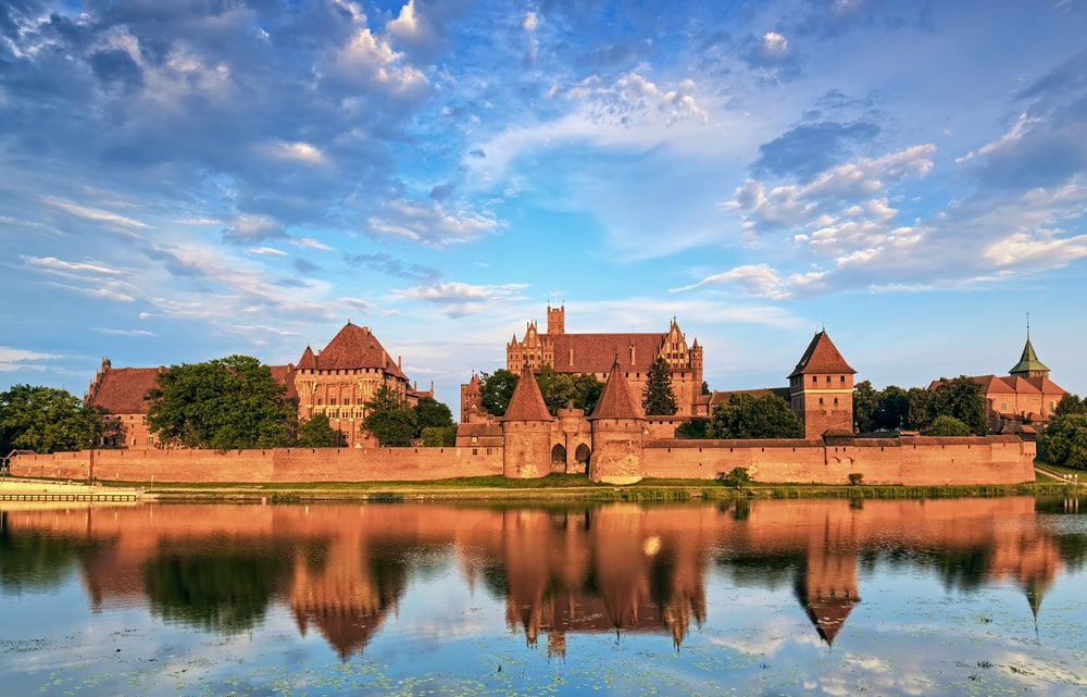 Teutonic Knights in Malbork castle in summer. World Heritage Lis